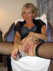 Mature woman masturbating with toys and..