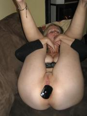 Shaved mature wife plays with buttplug..