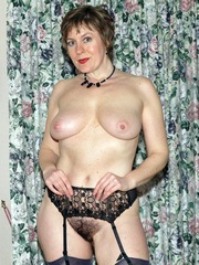 Mature housewife posing for pics nude..
