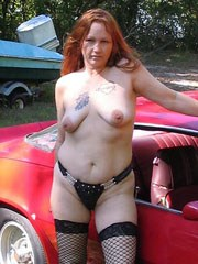 Kinky redhead wife in stockings poses..