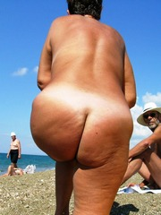 Mature wife on beach big tits hanging..