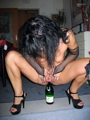Sexy brunette wife slides a beer bottle..