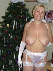 Blonde wife shows off her huge tits in..