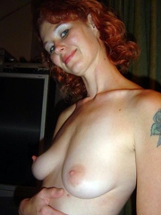 Sexy redhead wife shows her breasts and..
